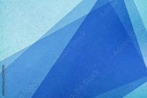 blue abstract background with layered shapes and copyspace