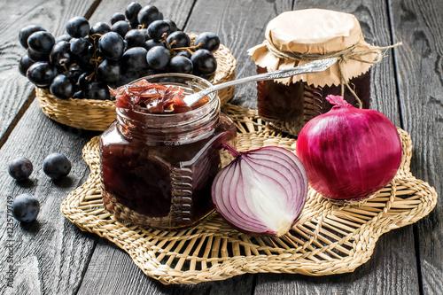 Fototapeta Onion jam with grapes in glass jars obraz