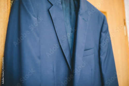 Fototapety, obrazy: Suit on a hanger