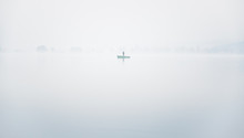 Alone Fisherman On The Boat In...