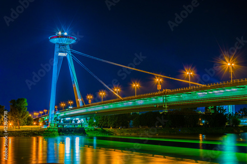 Photo  Night view of the illuminated SNP bridge over Danube in Bratislava