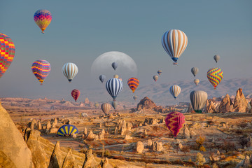 FototapetaHot air balloon flying over spectacular Cappadocia