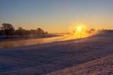 Fototapeta Na ścianę - Fog at the Elbe river near Torgau during a winter sunrise