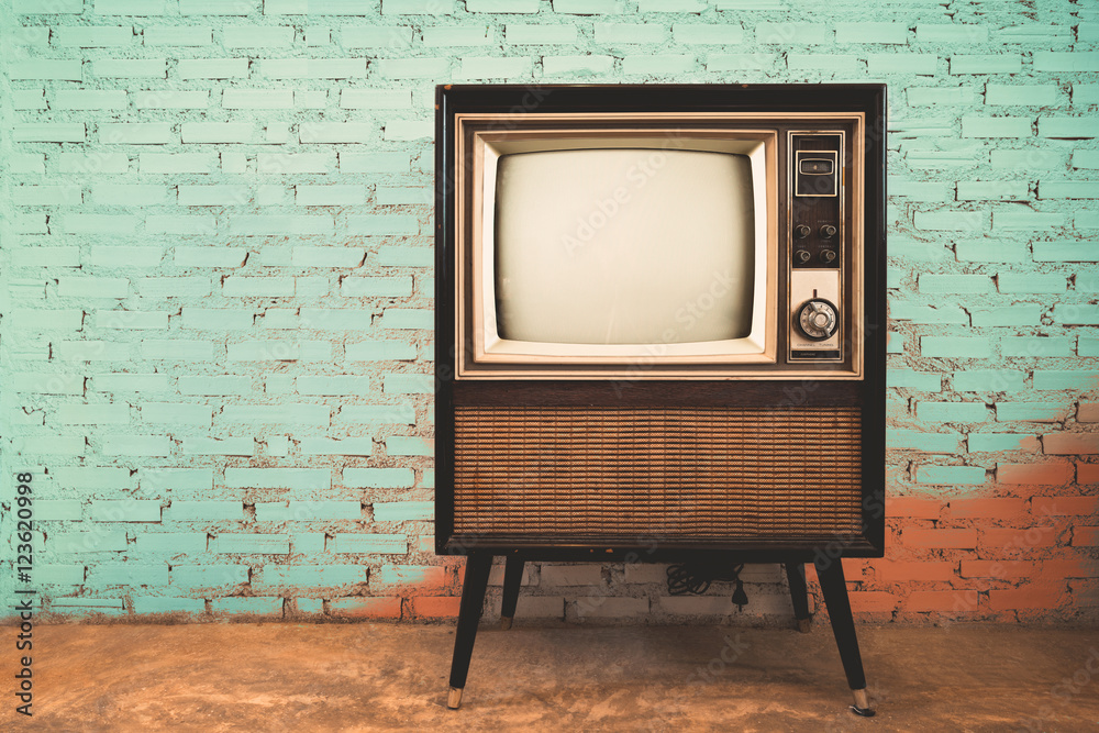 Fototapeta Retro old television in vintage wall pastel color background