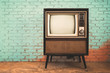 canvas print picture - Retro old television in vintage wall pastel color background