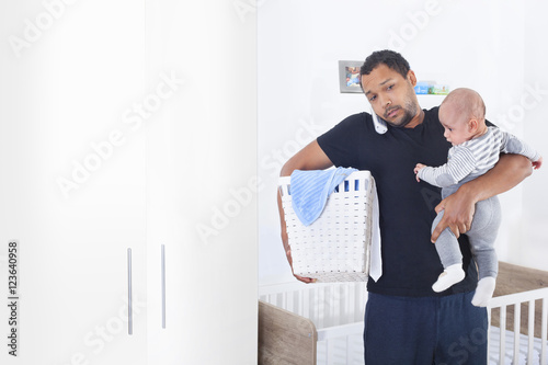 Photo  Single father overwhelmed by taking care of everything alone with copy space