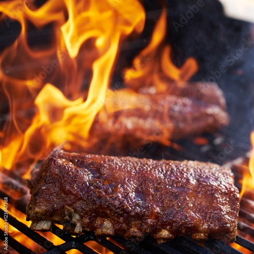 Aluminium Prints Grill / Barbecue bbq pork ribs cooking on flaming grill