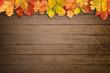 Leinwandbild Motiv Herbstlicher Hintergrund mit Holz