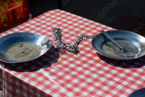 two dinner plate on chain, Polish PRL style Fototapeta