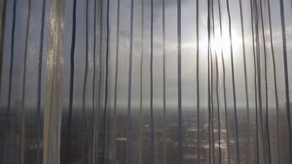 City view thru the transparent curtain