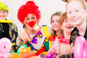 Clown at children birthday party with kids