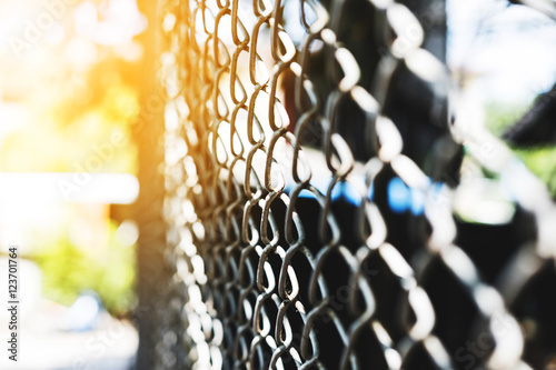 Steel net fence perspective view, selective focus with shallow depth of field Fototapet
