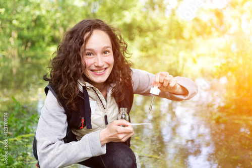 Young attractive biologist woman working on water analysis Canvas Print