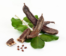 Fresh Carob On White Background