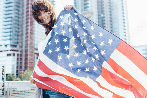 Young Beautiful Woman Waving an US Flag Brooklyn . New York City US