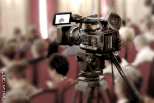 Abstract blurred background of video cameras recording in press conference. #123731742