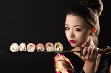 Fototapetabeautiful girl samurai with sword and rolls