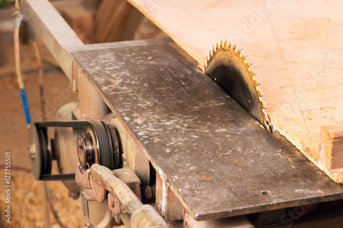 Fototapety, obrazy: Carpenter tools on wooden table with sawdust. Circular Saw. Carpenter workplace top view