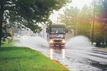 Lorry On Wet Road Rides Throug...