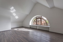 Indoor View Of An Empty Attic Of A New Modern House