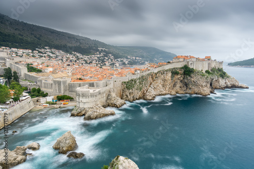 In de dag Mediterraans Europa A summer storm gathers over the medieval walled city of Dubrovnik, Croatia.