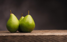 Three Pears On Wood With Space For Text