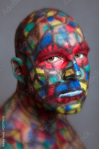 Fotografie, Obraz  Serious villain colorful face looking at you