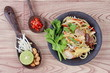 Fried sour sweet Chinese noodle with tofu with side dish are Thai organic food.