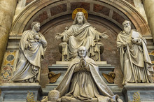 A Sculpture In St. Peter's Basilica Featuring Jesus, Saint Paul, Saint Peter And A Pope