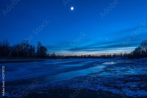 Foto op Canvas Donkerblauw night landscape river ice