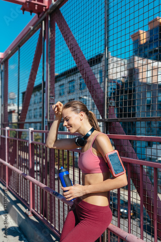 Young Runner Drinking Water After a Training . Williamsbrug Bridge Brooklyn NYC