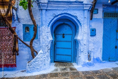 Traditional blue door on an old street inside Medina of Chefchaouen, Morocco