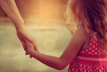 Mother And Daughter Holding Hands