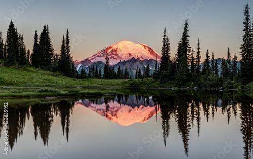 The Glowing Peak of Mount Rainier at Dawn with a calm reflection from the shore of Tipsoo Lake. Mount Rainier National Park