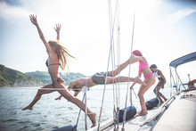 Friends Jumping Off Sailing Boat