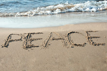 Peace Written In The Sand On T...