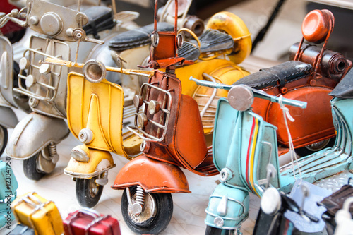 Foto op Canvas Scooter miniatures of italian scooter vespa
