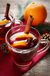 Glass cup of delicious Christmas mulled wine on napkin, closeup
