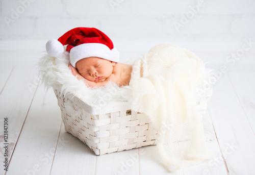sleeper newborn baby in  Christmas Santa cap Canvas Print