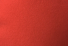 Close-up Of Red Polar Fleece Fabric With Pilling, Material Texture