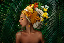 Young Woman In Turban With Flo...