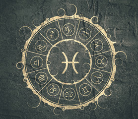 FototapetaAstrological symbols in the circle. Concrete wall textured. Fish sign