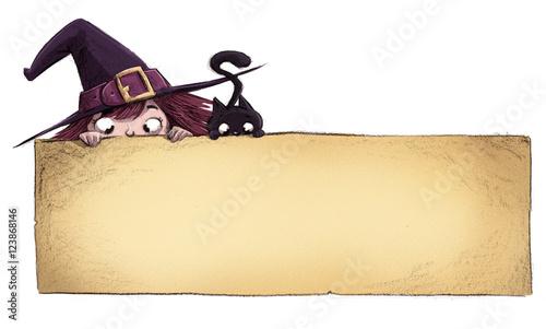 Fotografía  bruja y gato con cartel