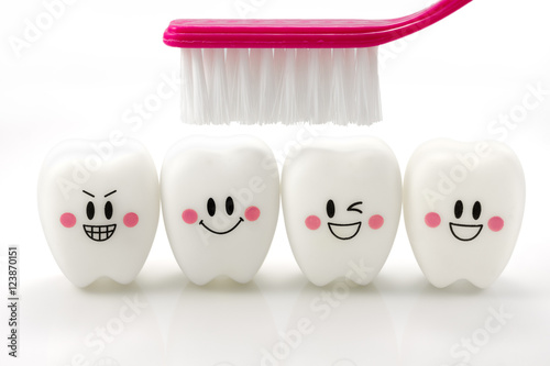 Fotomural Toys teeth in a smiling mood isolated on white background with clipping path