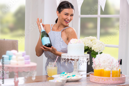 Fotografie, Obraz  Party planner wife mother decorating a champagne mimosa brunch birthday bridal b