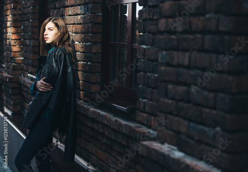 b9d9d70f88 Lifestyle fashion portrait of brunette girl in rock black style ...