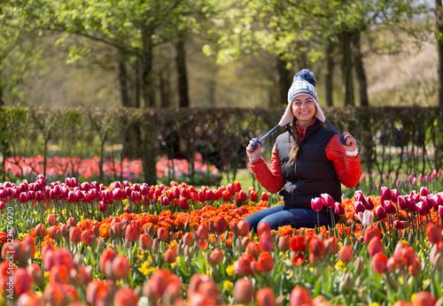Photo  Girl in Flowers in the park Keukenhof