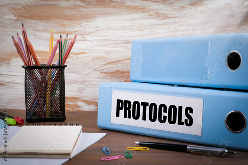 Fotografía  Protocols, Office Binder on Wooden Desk. On the table colored pe