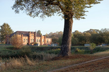 Brick Building Near The Water In Autumn