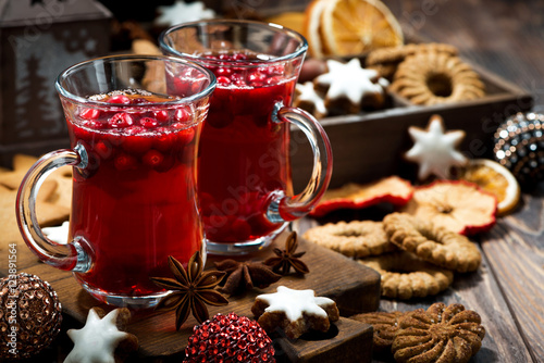 Photo sur Toile The Christmas drink hot cranberry tea and cookies on dark background